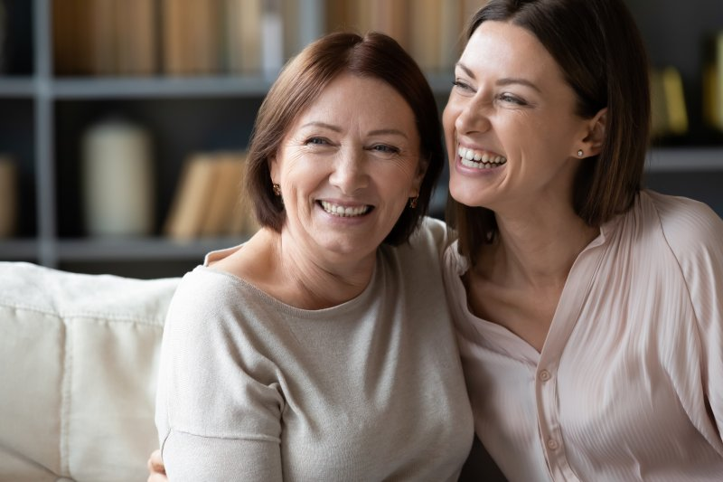 mother and adult daughter laughing together